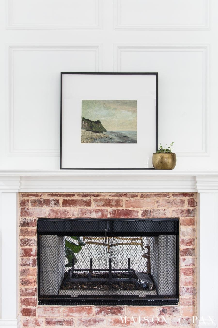 large art piece (vintage: beach scene) and potted succulent above mantel | Maison de Pax