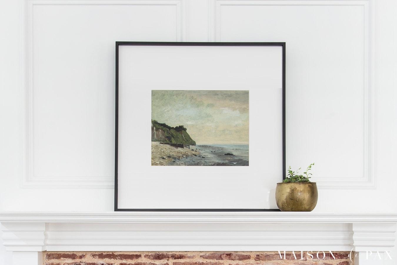 beach print in black frame above mantel | Maison de Pax