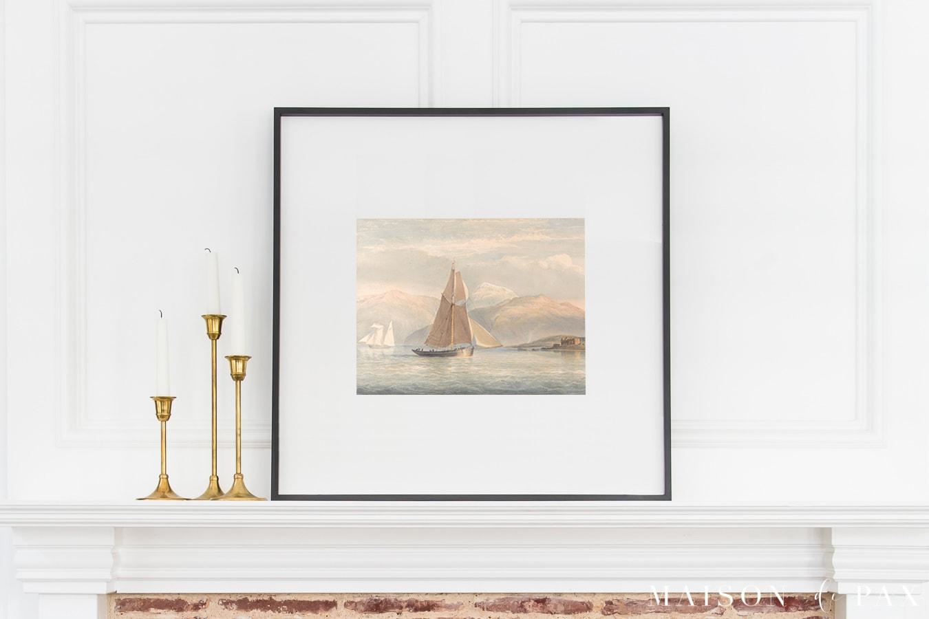 sailboat print in black frame above fireplace | Maison de Pax