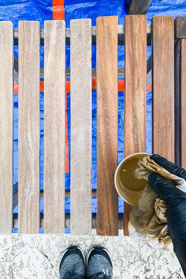 applying teak protector to raw teak wood