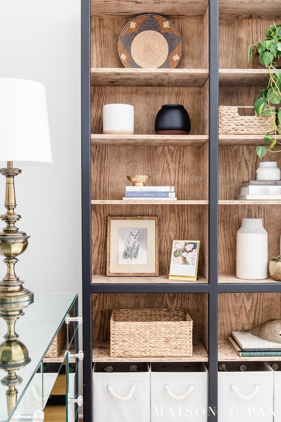 black styled bookcase with light wood inside