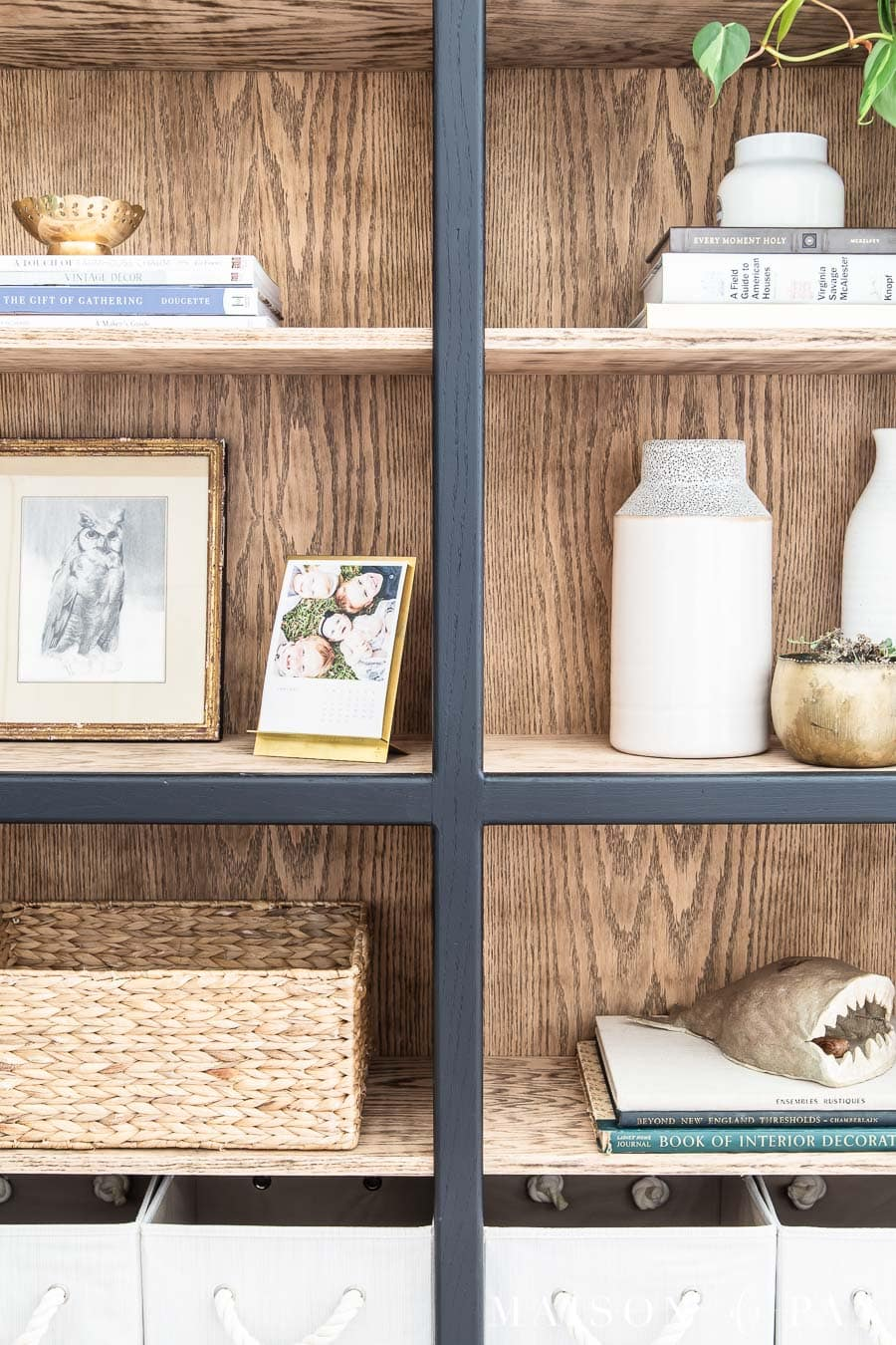 black and wood bookcase with natural wood look inside | Maison de Pax