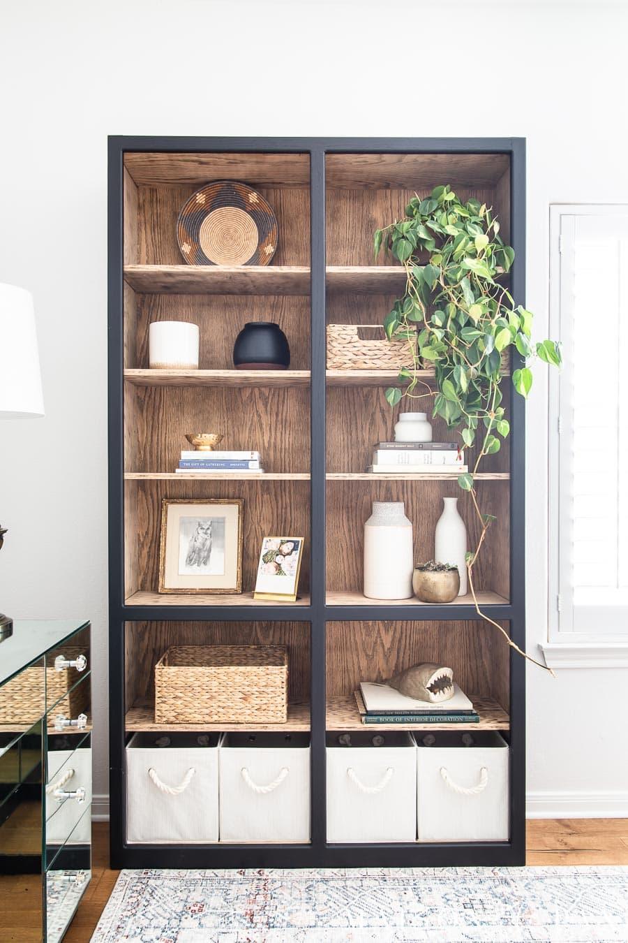 black bookcase with light wood interior | Maison de Pax