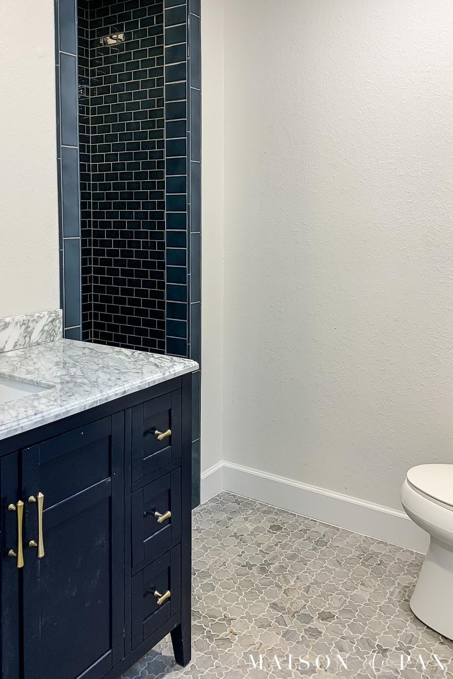 geometric marble mosaic floors in small bathroom