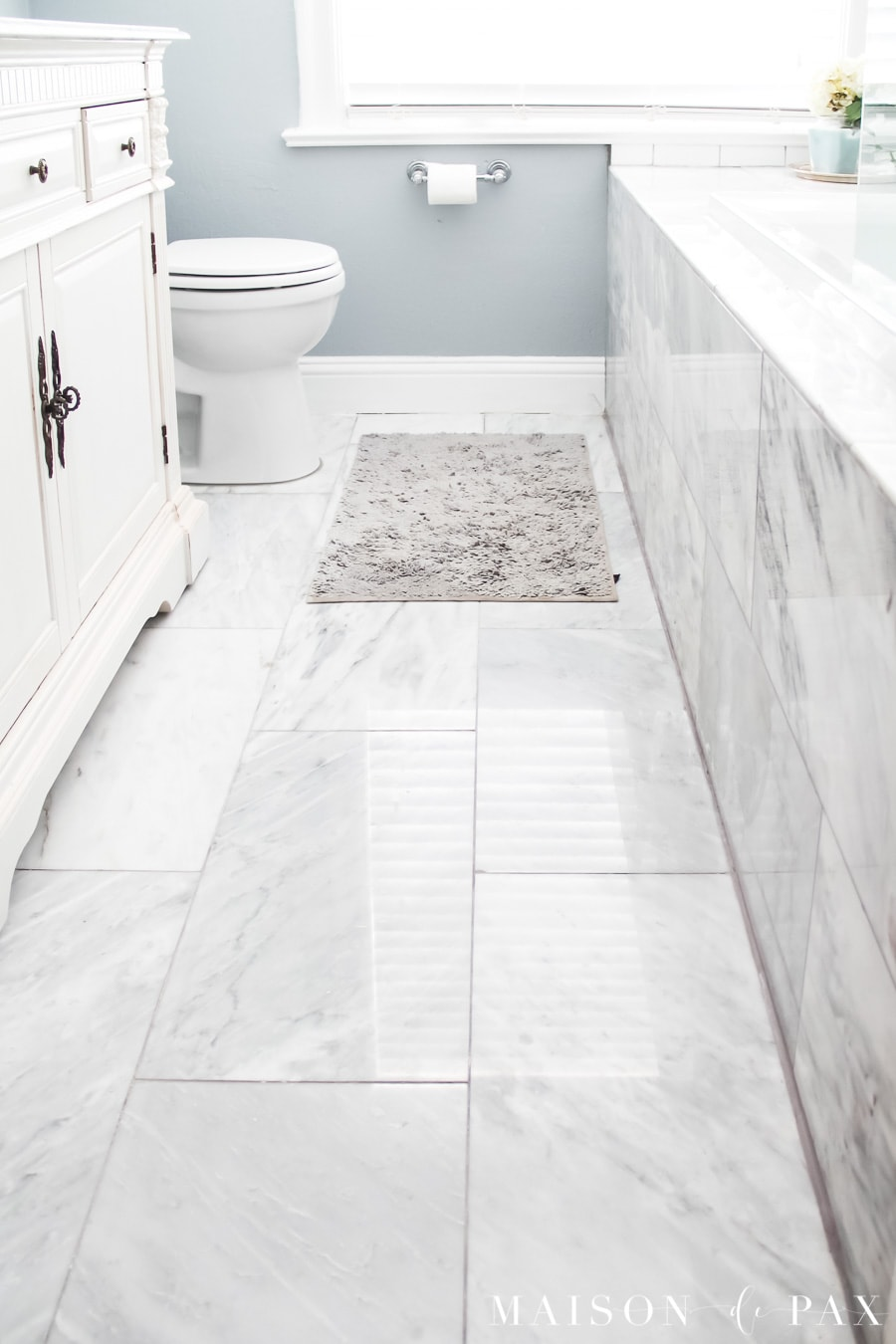 small bathroom with 12x24 marble tiles floor