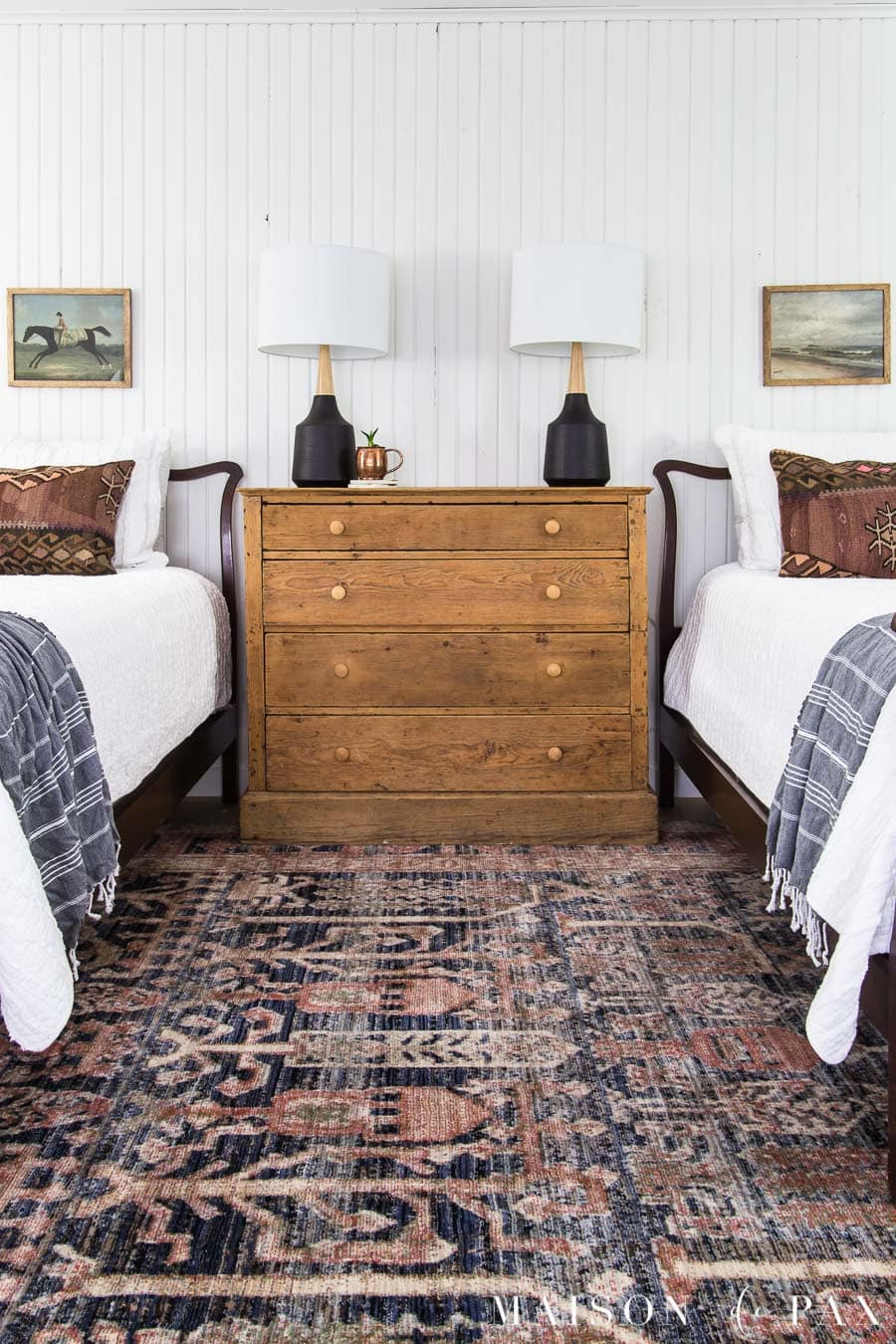 twin beds with vintage art above