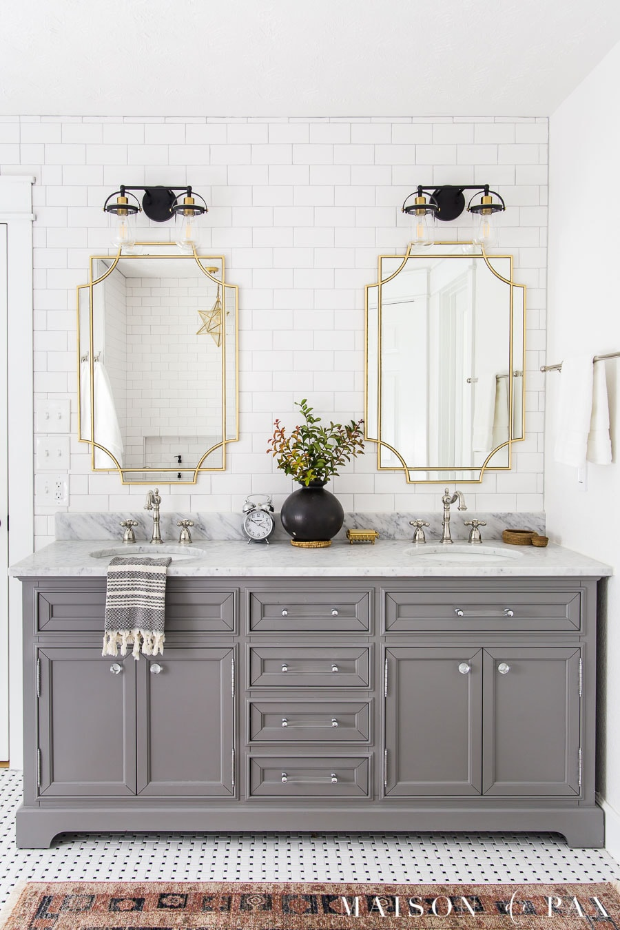 gray vanity with storage and marble top two sinks