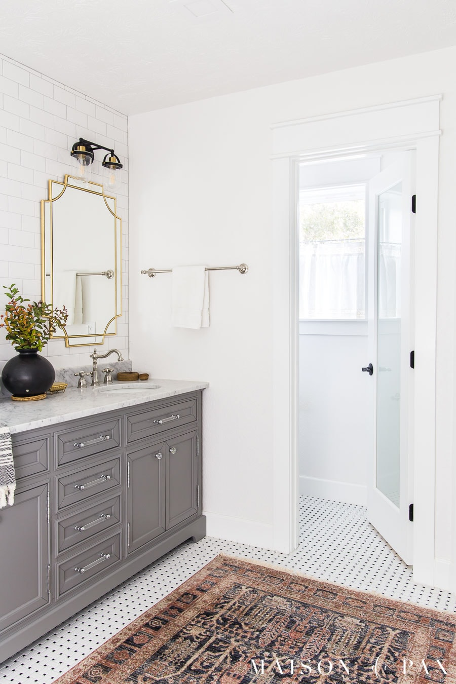 frosted glass door on water closet to allow in light