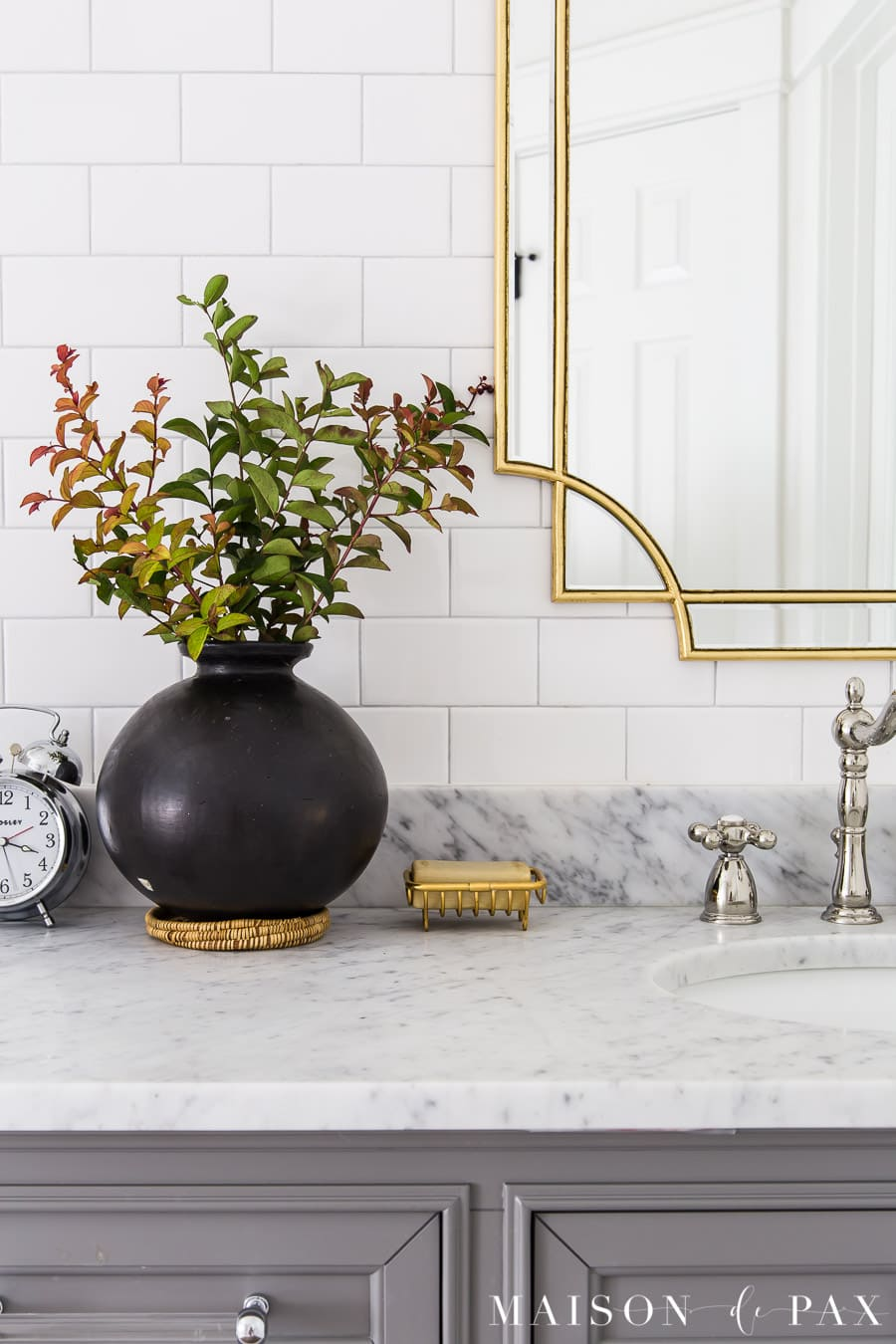 black pottery on marble top vanity