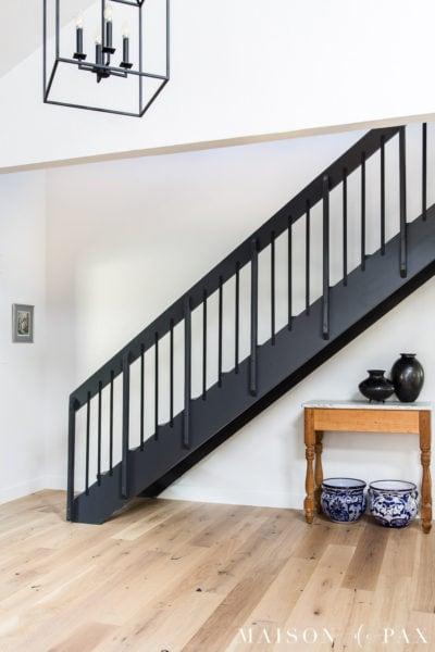 black iron stair railings on floating stairs