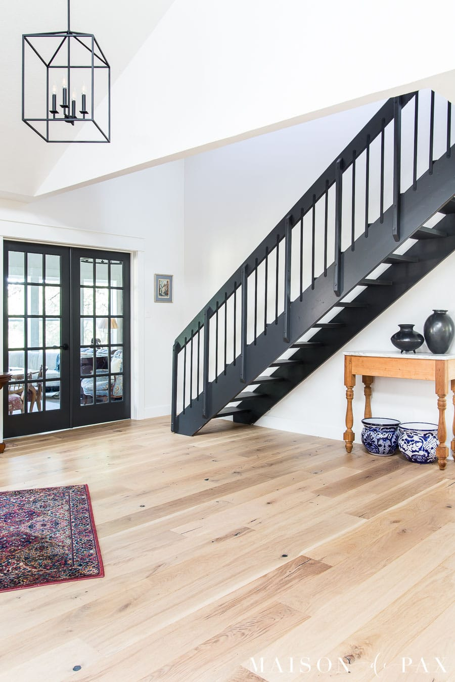 french doors and stairs in entryway with black iron stair railing, SW Iron Ore