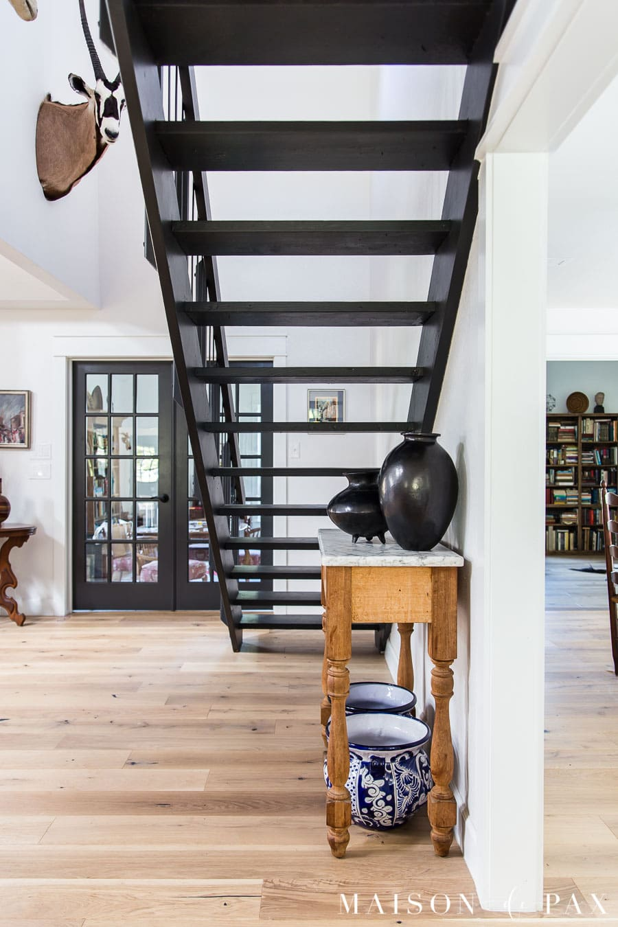 see through black floating staircase in eclectic home