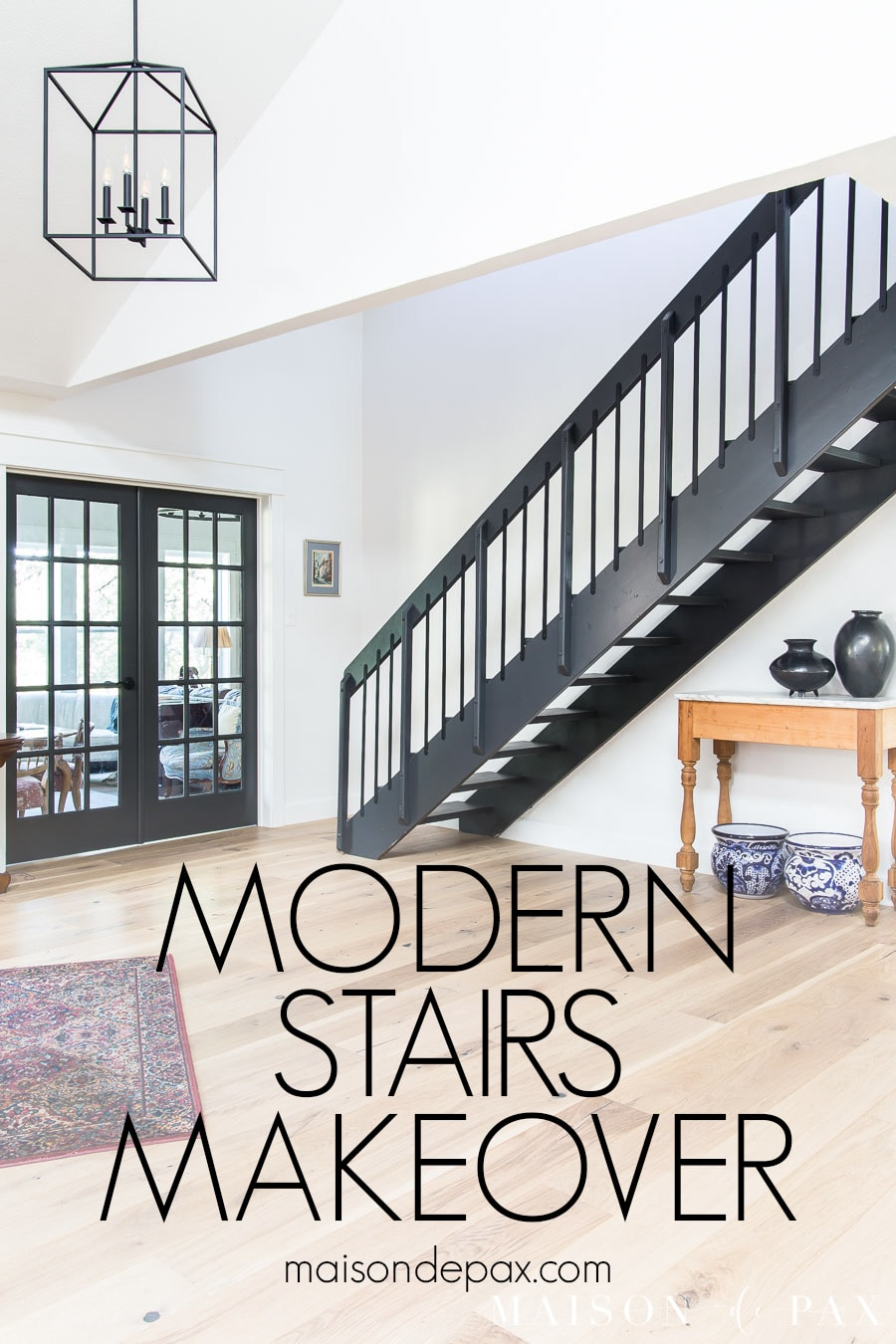 modern stairs makeover with black iron railing and balusters