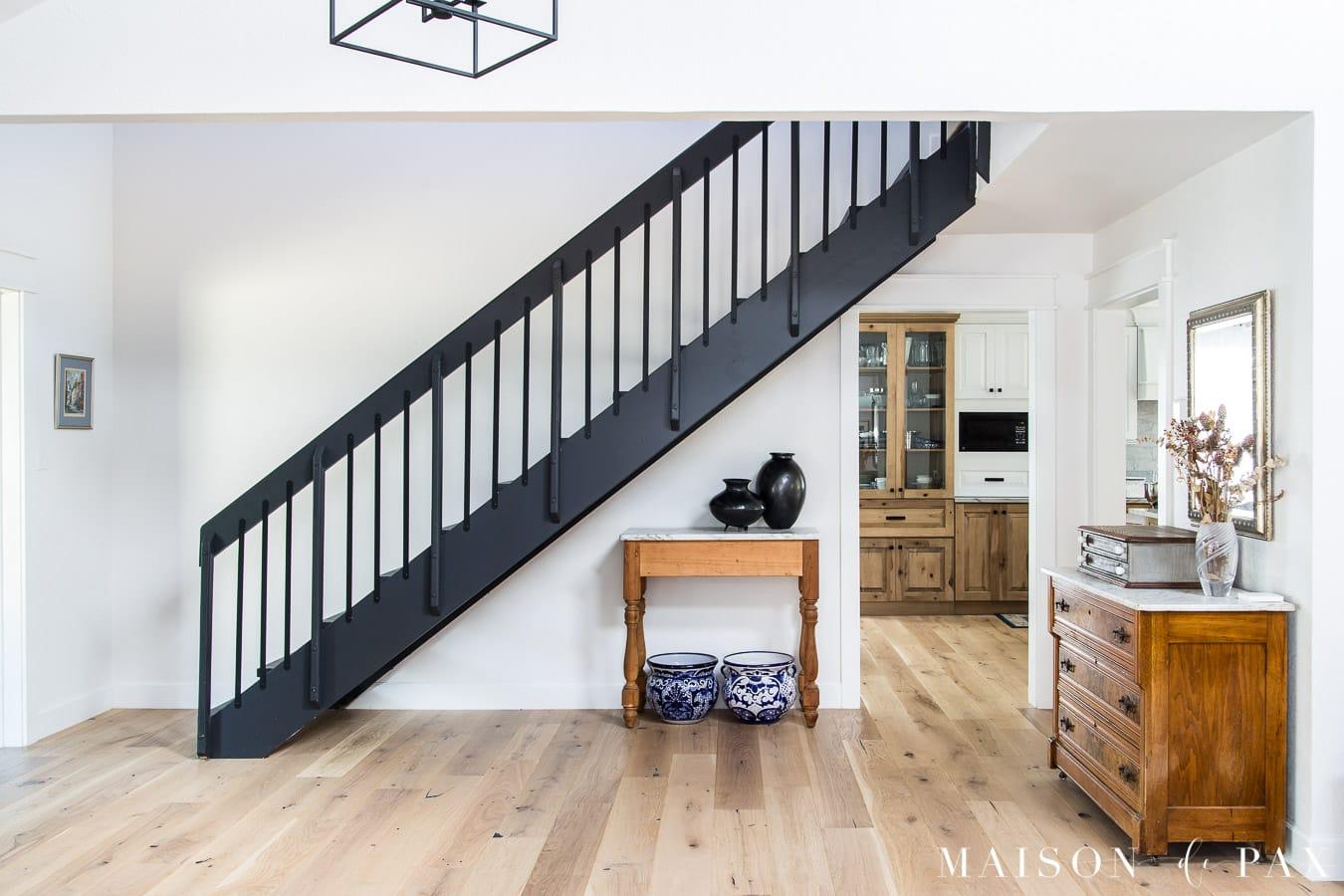 modern black stairs in entryway